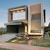 Fachada de casa contemporânea cinza, com volumetria e vidro refletivo!