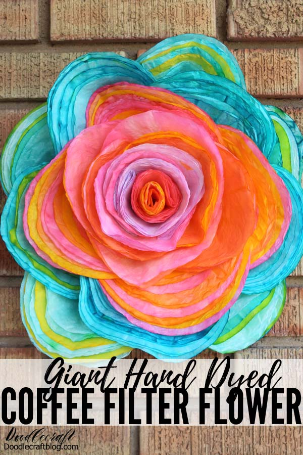 Make a giant hand dyed coffee filter flower rose with layers of coffee filters dyed with food coloring.