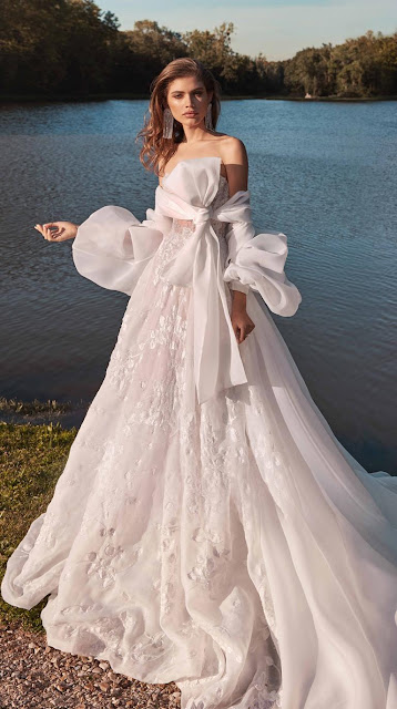 MEGHAN A voluminous coat with balloon sleeves that fasten at the neckline with an oversized statement bow—an elegant add on to any Couture collection gown - wedding ideas - wedding planning services in Philadelphia PA - weddings ideas blog by k'Mich Weddings - Galia Lahav