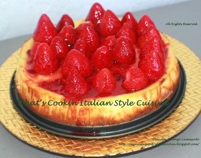 this is a homemade from scratch strawberry cream cheese cheesecake a copycat from Utica New York wiith whole strawberries and glazed