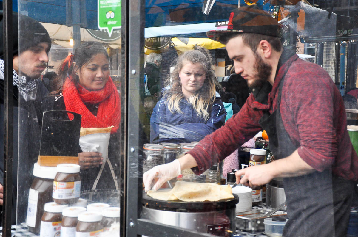 A pancake maker, Camden Lock Market, Camden Town, London, England