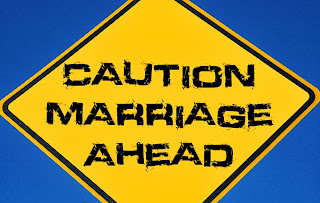 A Sign Saying Caution Marriage Ahead