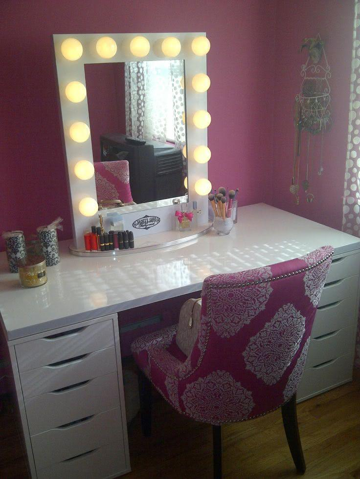 Dressing table with pink armchair