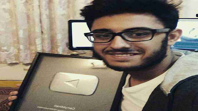 CarryMinati with play button