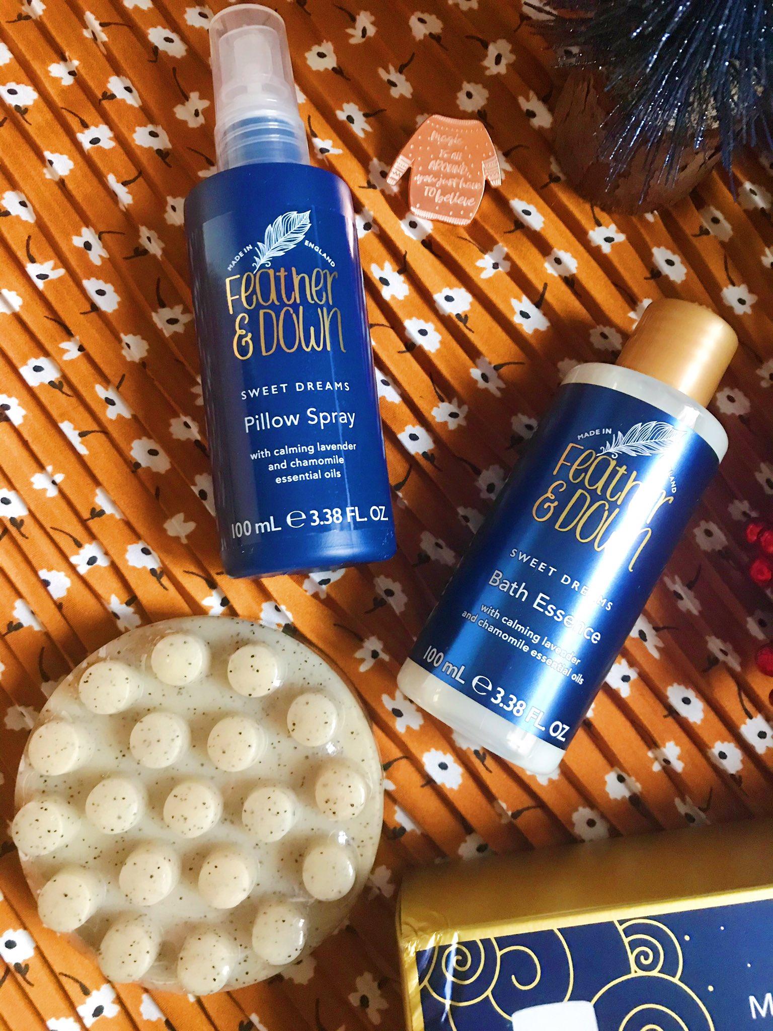 Feather & Down Massage to Sleep gift set on orange background - bath essence, pillow spray, massage bar