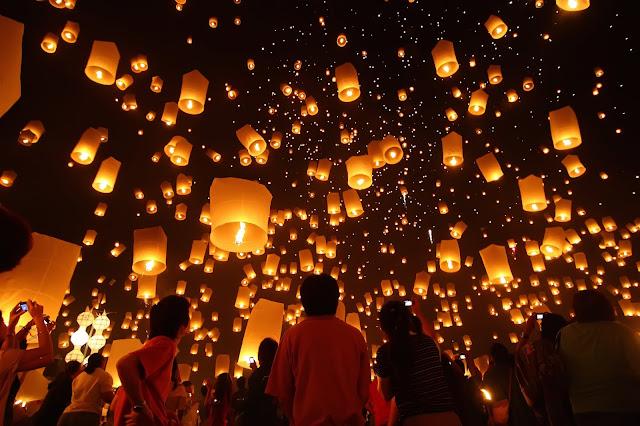 Orange glow from lanterns instead of white UFOs.