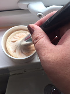 Wet makeup brush swirled in the hard soap