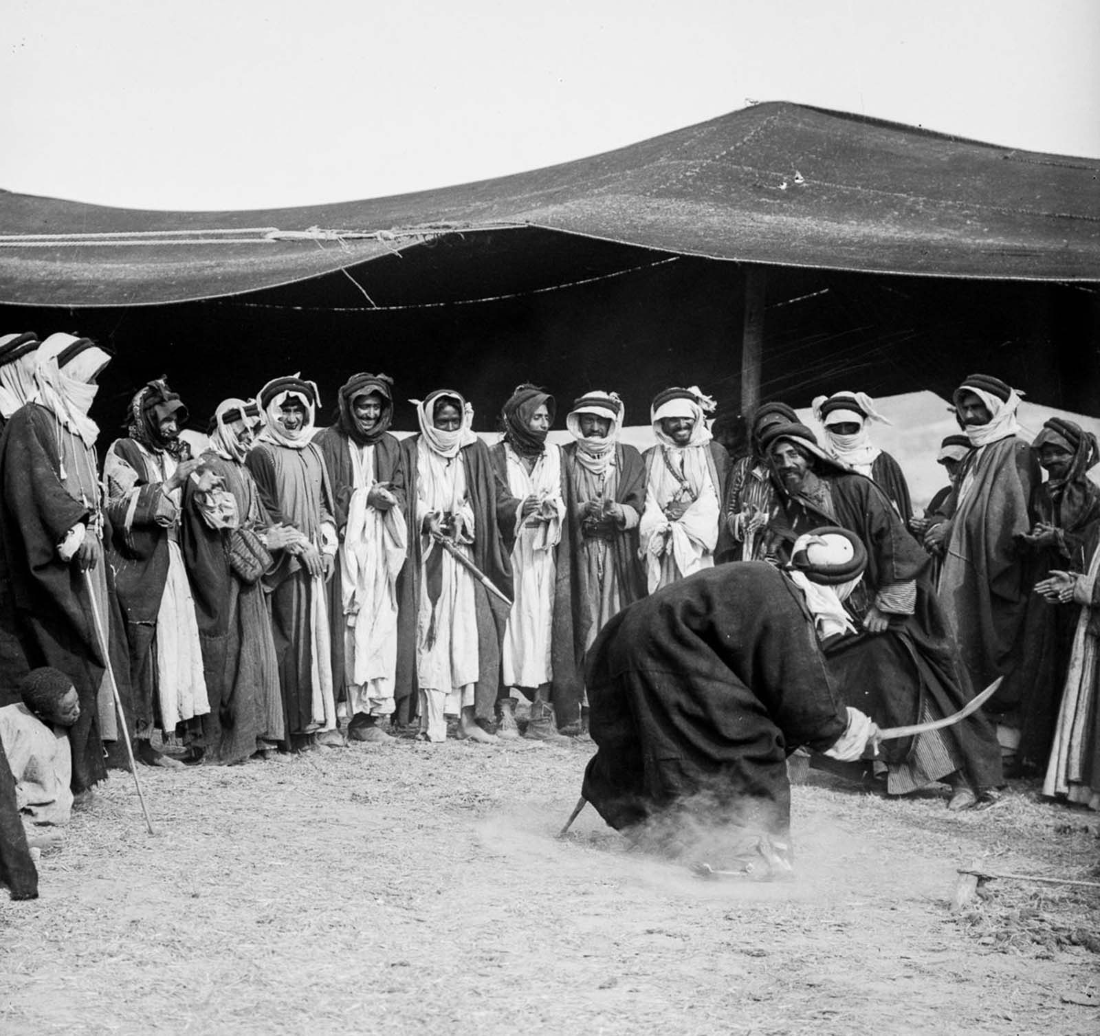 Men perform a sword dance at a wedding.