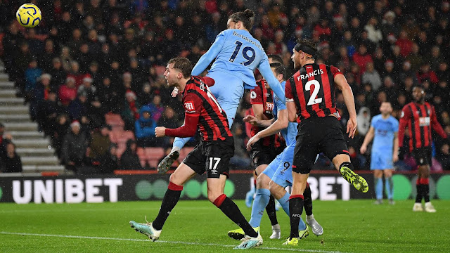 Burnley forward Rodriguez beats two Bournemouth defenders to a header during a Premier League match
