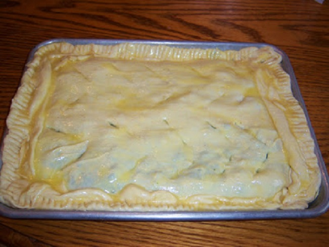 this is a delicious savory pie ready to be baked using puff pastry dough