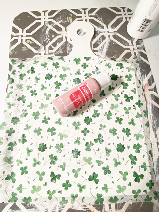 shamrock napkin on cutting board shape with paint roller