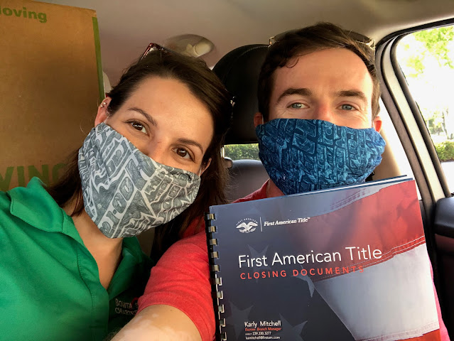 me and Matt in the car, wearing masks, with our signed title transfer document