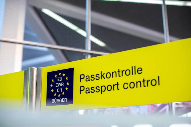 EU passport control sign; Photo by Daniel Schludi on Unsplash