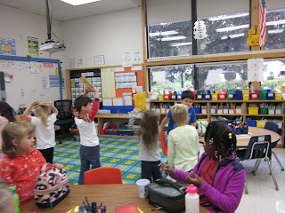 Students doing a parade with books.