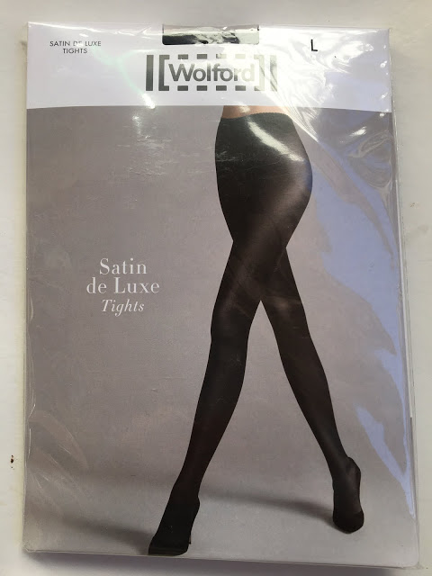 06c2617ff0408 Included in the generous box of samples was a pair of the Wolford Satin De  Luxe Tights.