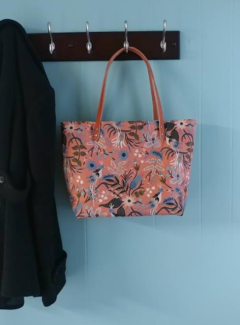 Leather handles, rivets, and a canvas Les Fleurs fabric by Rifle Paper Co. and Cotton + Steel make this a great tote bag for summer!