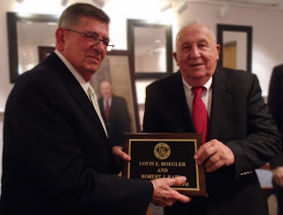 Founding School Committee members Robert J. Rappa, of Franklin, and Louis E. (Ted) Hoegler, of Walpole, pose for photo