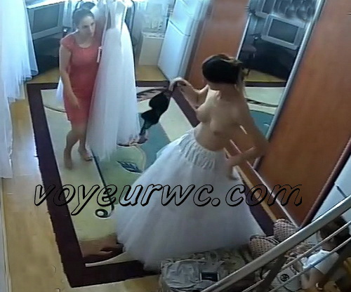 Voyeur dressing room video with girls trying on wedding dresses