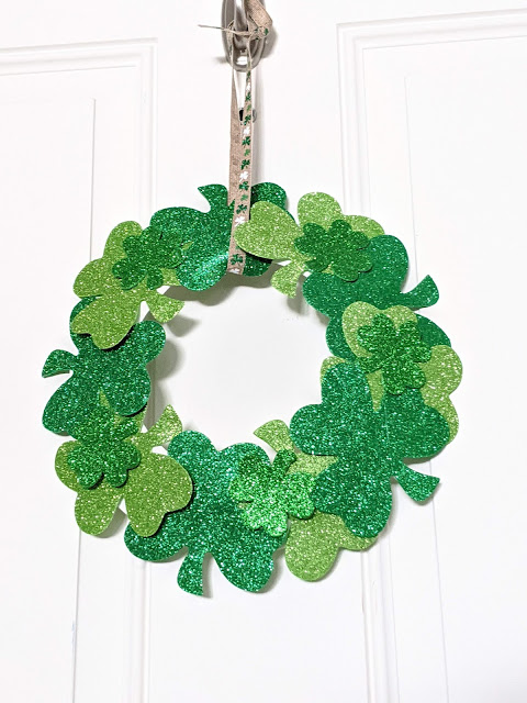 easy DIY shamrock wreath for St. Patrick's Day hanging on a door
