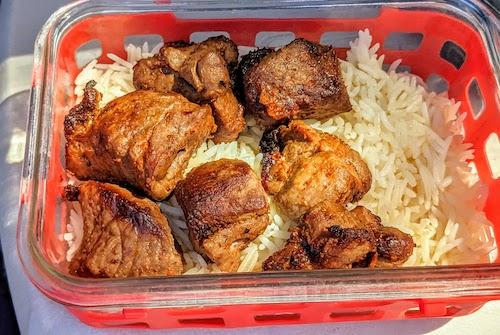 Lamb shish kabob over rice