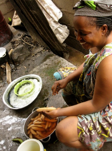Happily cooking in Cameroon