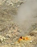 Sulphuric smoke rises from the ground at Solfatara