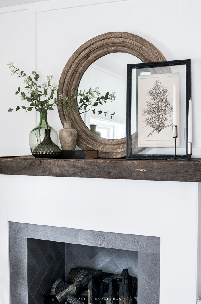 Mantel filled with vases and decor
