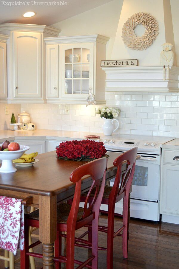 Red country kitchen with red bar stools at island