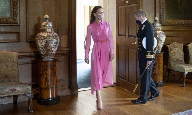 Kate Middleton wore a new bubblegum pink silk shirt dress from Me + Em, and lollipop skinny belt from Boden