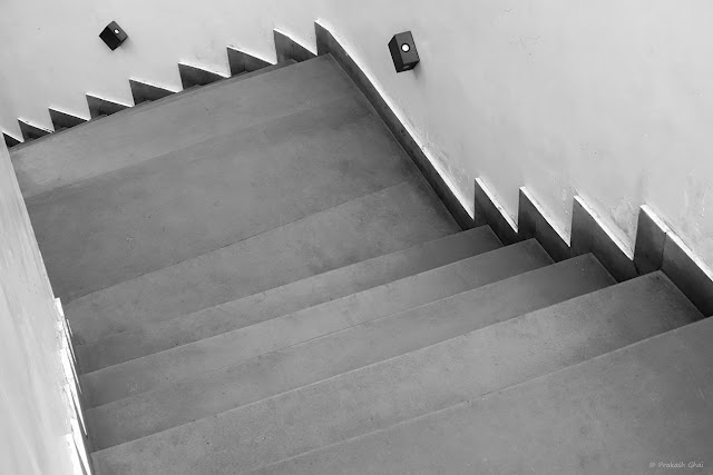 A Black and White Minimal Art Photograph of a Staircase at Forresta Cafe Jaipur.