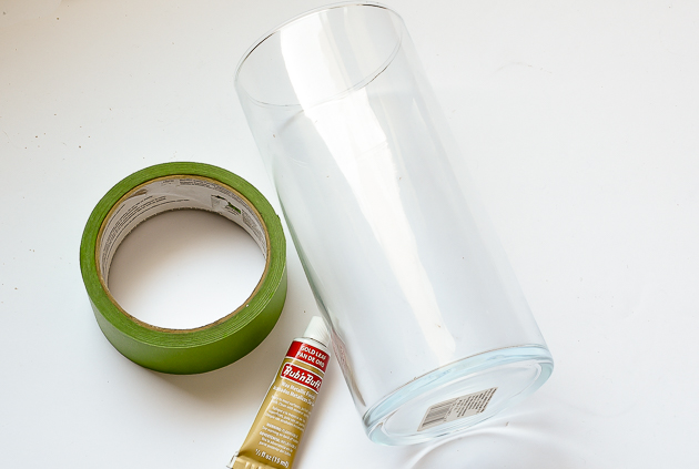 Supplies for updating Dollar Tree glass vase, frog tape, gold leaf rub 'n buff