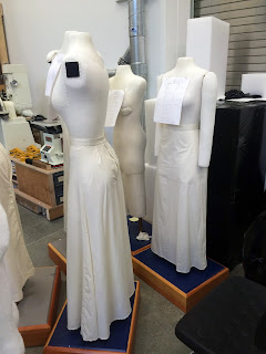 Group of mannequins wearing muslin skirts.
