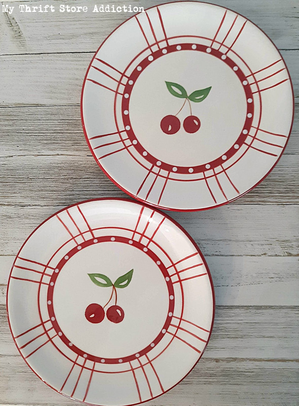 red and white cherry plates