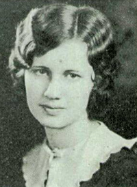 A 1930s yearbook photo of a young woman with a cap of dark wavy hair