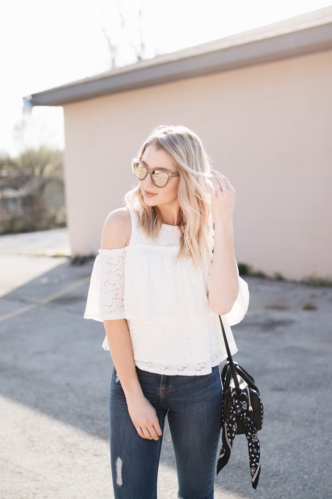 spring outfit: lace top with oversized sunglasses