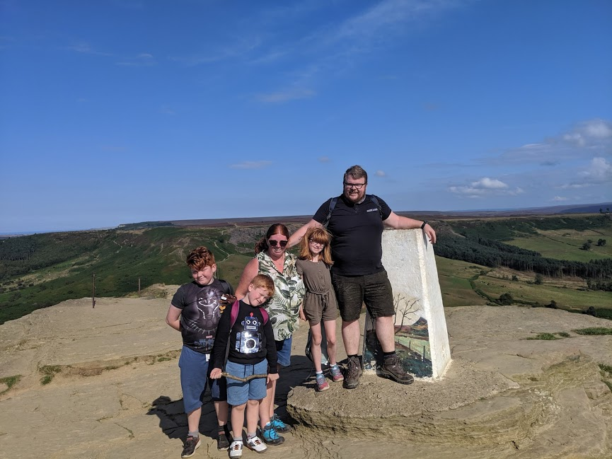 Climbing Roseberry Topping with Kids - family photo at the top