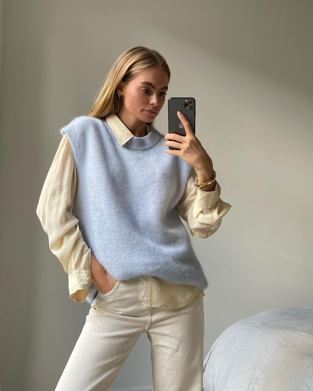 25 Sweater Vests to Wear Now — @clairerose in a light blue sweater vest