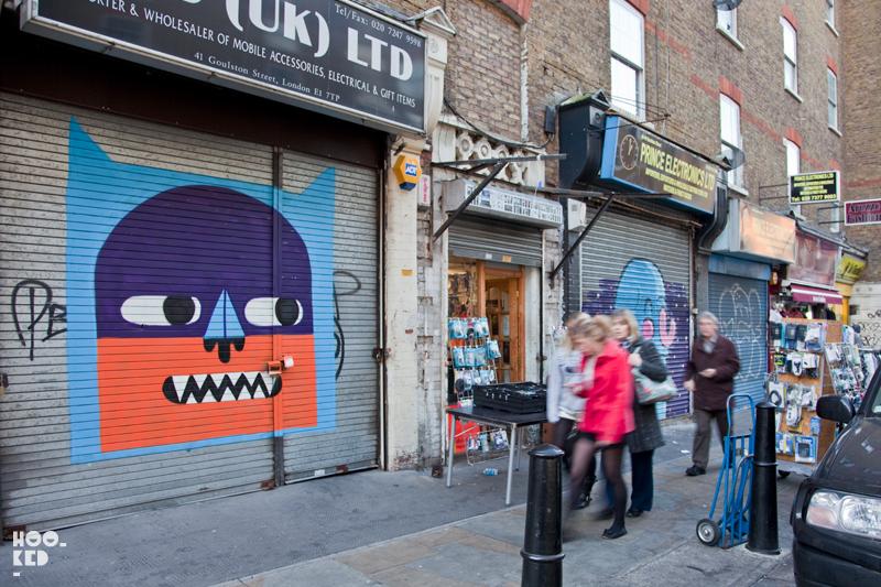 London Street Art roller shutter spray painted by artist Malarky