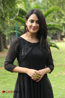 Actress Mia George Stills in Black Dress at Oru Naal Koothu Press Meet  0014
