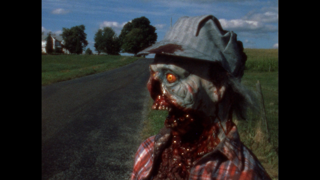 zombie watches a car drive by