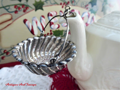 https://www.antiquesandteacups.com/products/antique-1887-sterling-silver-teapot-spout-tea-strainer-basket-whiting-usa-tea-leaf-catcher?_pos=1&_sid=ca4acb894&_ss=r