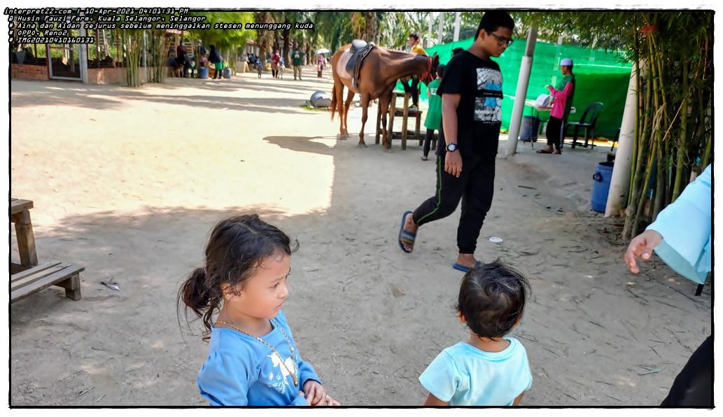 Picture of Aina and Aidan after finishing the horse riding activity at Husin Fauzi Farm Kuala Selangor.