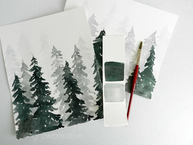 Decorate your home with simple watercolor winter forest paintings, some pretty white frames, and gold twigs.  Original paintings by Elise Engh