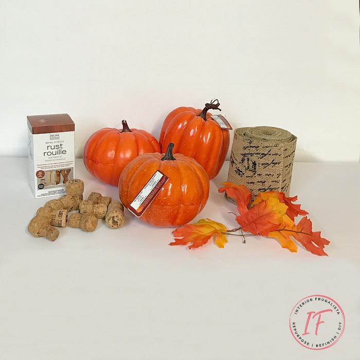 How to turn plastic dollar store pumpkins into unique French script burlap decoupage pumpkins with faux rusted iron leaves and fun wine cork stems.