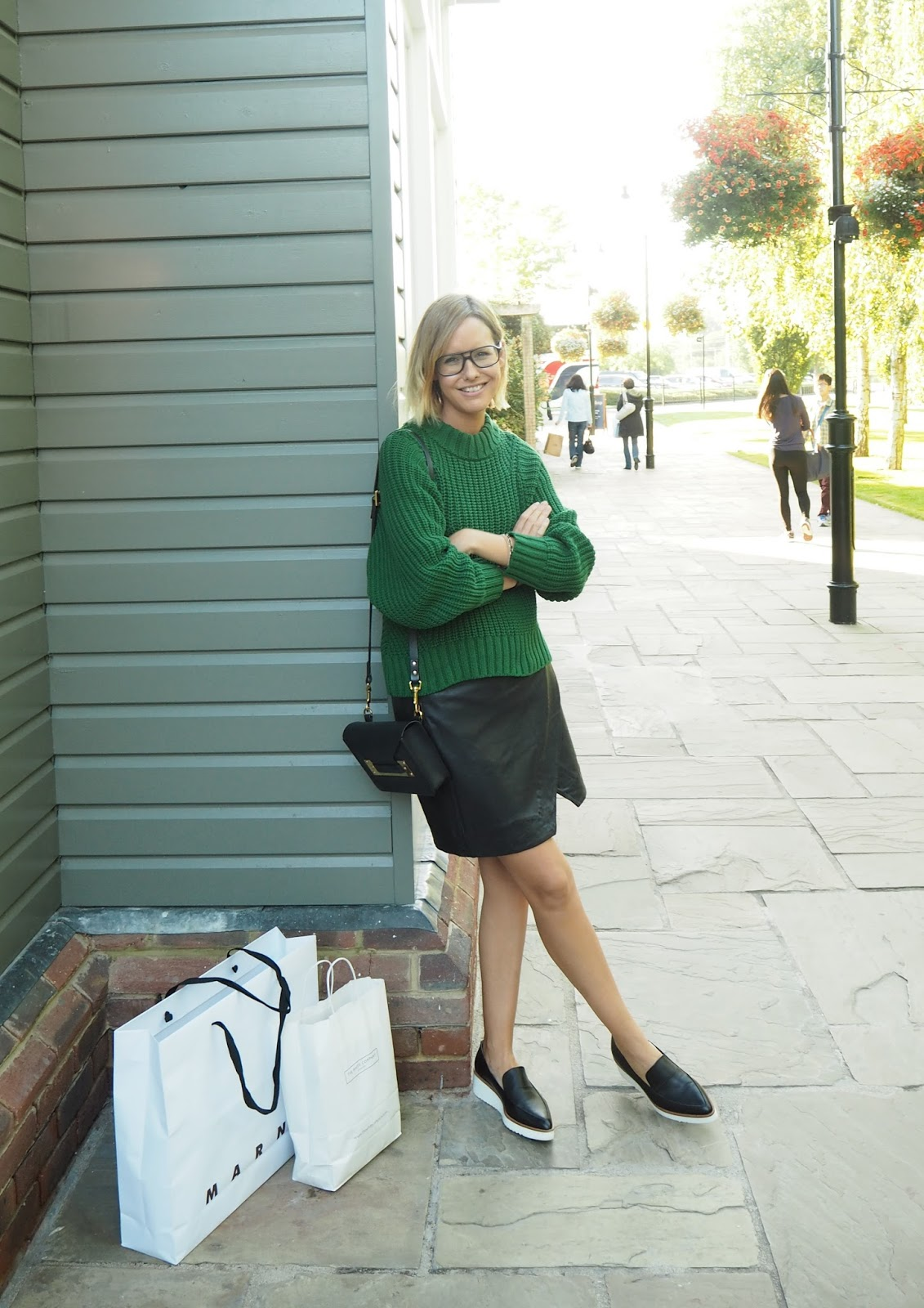 5f8fca196 Jumper: £29.99, H&M (in store now). Leather skirt: £160, Hush. Bag: Sophie  Hulme. Shoes: Next (old).