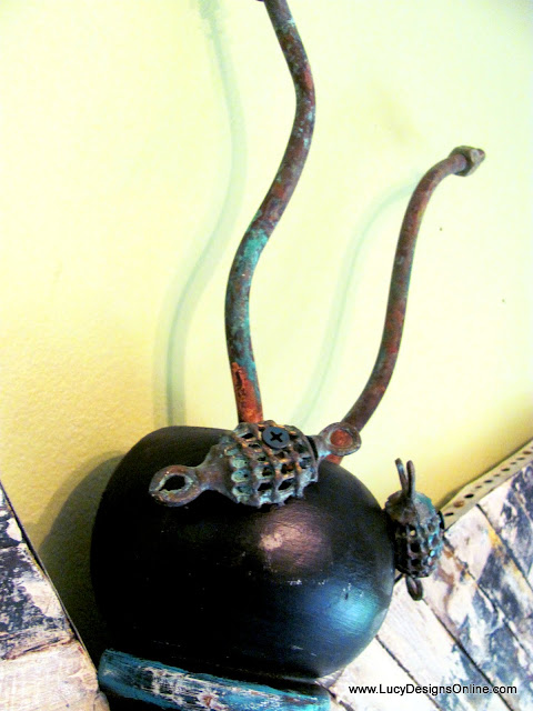 verdigris copper pipe pieces used as antenna on butterfly art