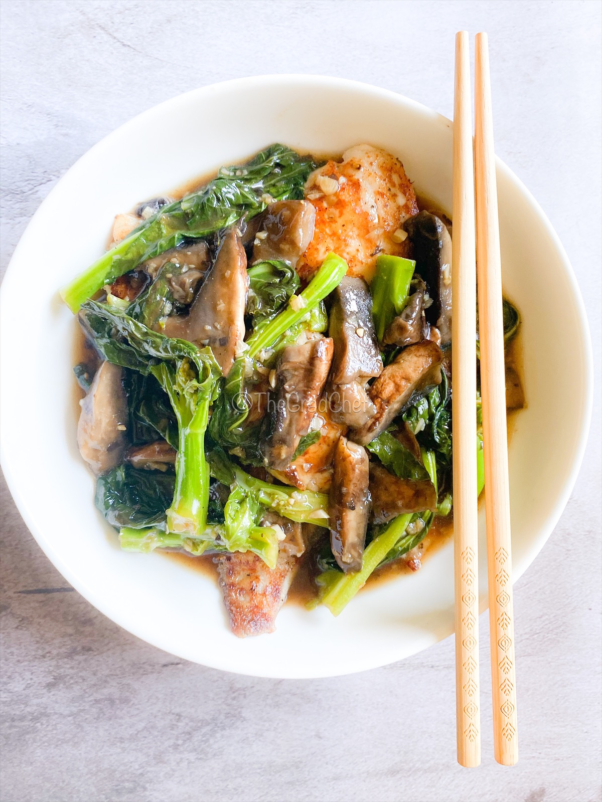 GRILLED FISH WITH GAI LAN AND MUSHROOM