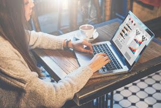 Woman analyzing data on laptop computer
