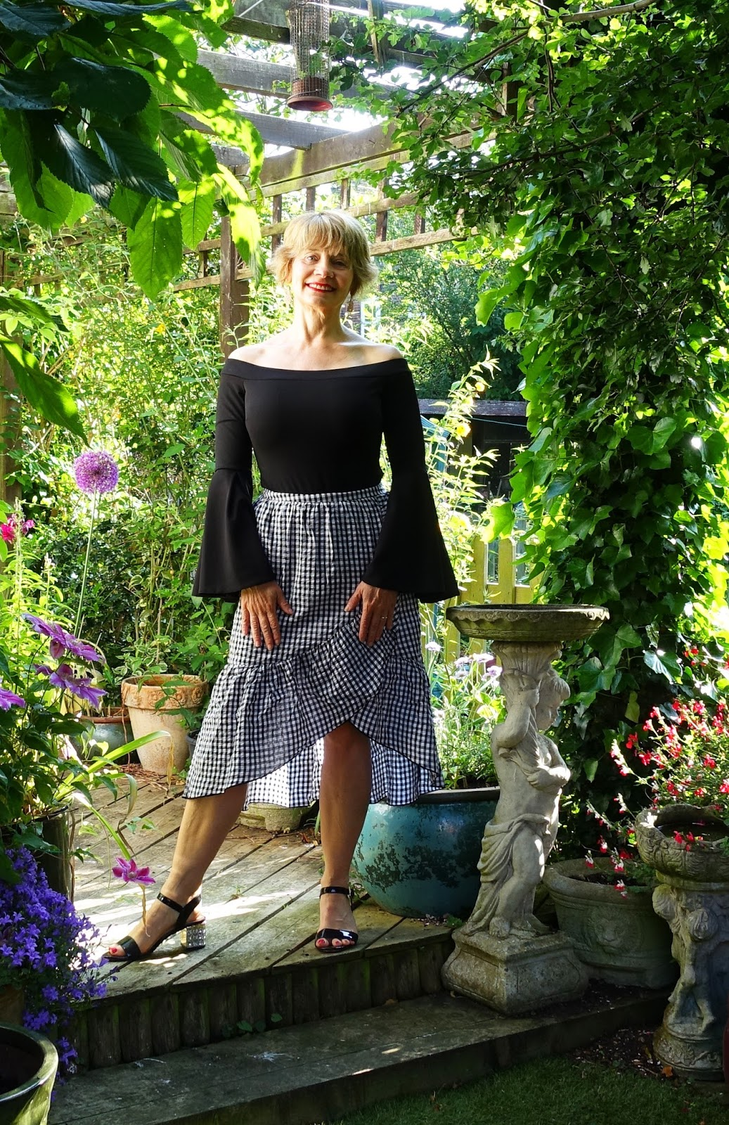 23e66069cc43 Embellished heels from Dune go well with a flamenco inspired gingham skirt  · Great tiering on this Mango gingham skirt worn with black sandals and  Bardot ...