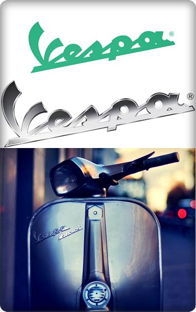 Logo Vespa dengan huruf tersambung dan miring ke atas
